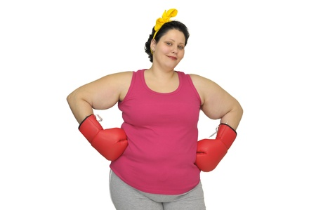 Large young woman with boxing gloves isolated in white photo