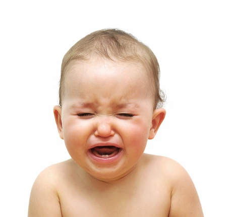 Young baby girl crying isolated in white photo