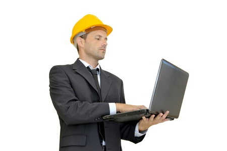 Engineer with hat and laptop isolated in white photo
