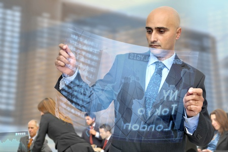 Businessman with high tech stock exchange newspaper photo