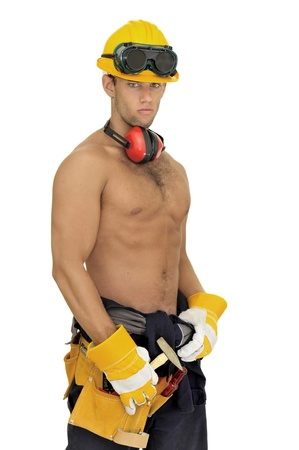 sexy construction worker: Muscular construction worker posing isolated in white