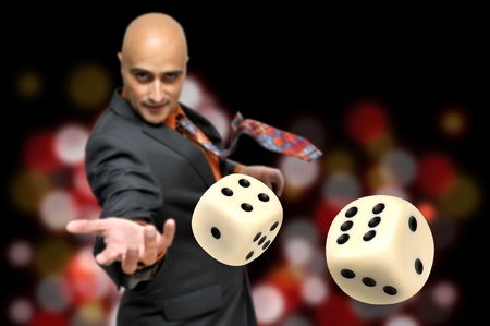 craps: Man in a suit playing dice