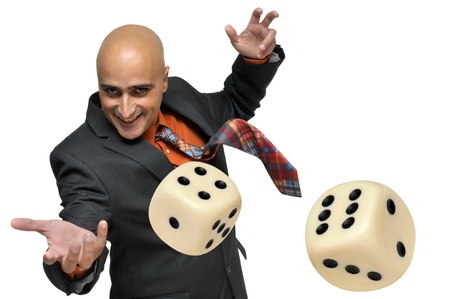 a pair of: Man in a suit playing dice isolated in white
