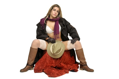 Sexy girl in cowboy outfit isolated in white photo