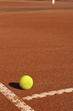 Detail of a clay court with tennis ball photo