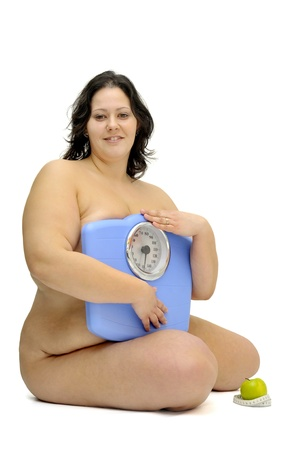 gluttony: Beautiful nude large girl with weight scale isolated in white