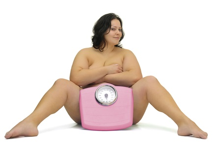 Beautiful nude large girl with weight scale isolated in white Stock Photo - 8993704