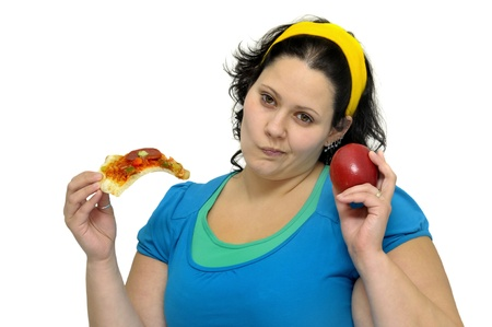 Large girl with an apple and a pizza slice isolated in white photo