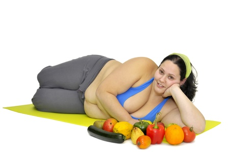 Large girl with vegetables isolated in white Stock Photo - 9120850