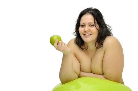 Beautiful nude large girl with an apple isolated in white photo