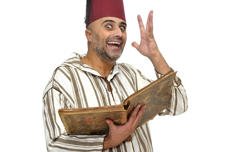 Arabic man with very old book isolated in white Stock Photo - 9120851