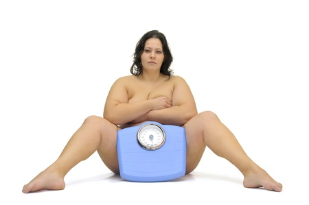 Beautiful nude large girl with weight scale isolated in white Stock Photo - 9120864