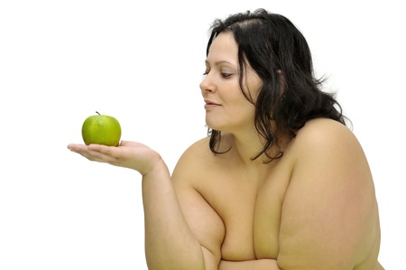 obese girl: Beautiful nude large girl with an apple isolated in white