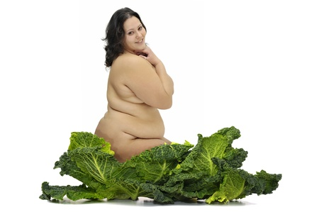 Beautiful large girl with vegetables isolated in white Stock Photo - 9120908