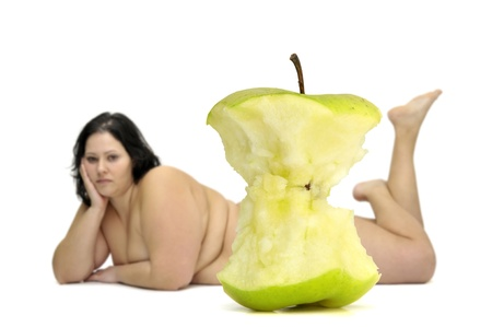Eaten apple with beautiful nude large girl in the background Stock Photo - 9120899