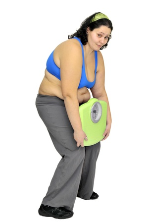 Large girl with weight scale isolated in white Stock Photo - 9213631