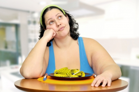 Large girl eating a measuring tape  photo