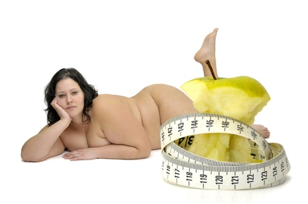 Beautiful nude large girl with eaten apple and measuring tape in the foreground