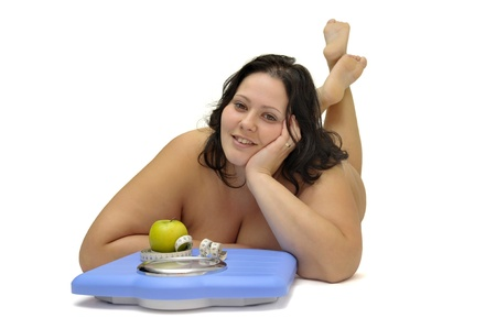 Beautiful nude large girl with weight scale isolated in white Stock Photo - 9213629