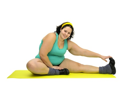 gluttonous: Large girl exercising isolated in white Stock Photo