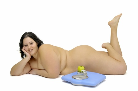 Beautiful large girl with weight scale isolated in white Stock Photo - 9210477