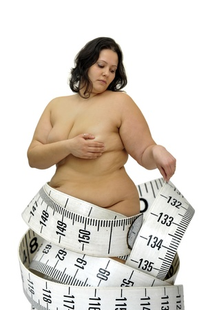 obesity: Beautiful large with measuring tape girl isolated in white