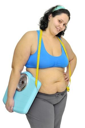 gewicht skala: Gro�e M�dchen mit Waage isoliert in wei�