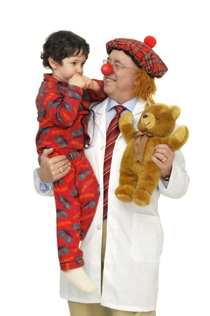 Doctor with clown faceholding a child isolated in white Stock Photo