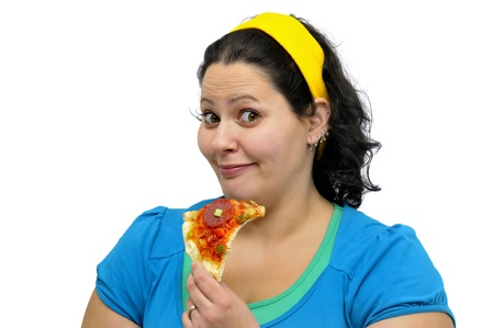 Large girl eating a pizza slice isolated in white photo