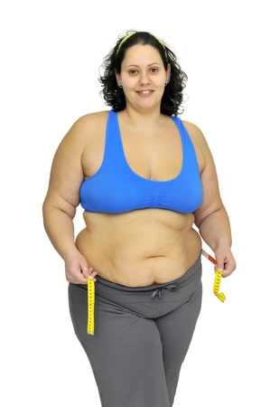 gluttonous: Large girl with measuring tape isolated in white