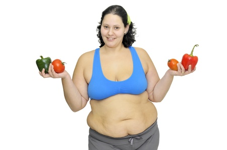 Large girl with vegetables isolated in white Stock Photo - 9382409