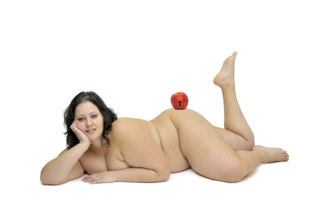 gluttonous: Beautiful nude large girl isolated in white with apple