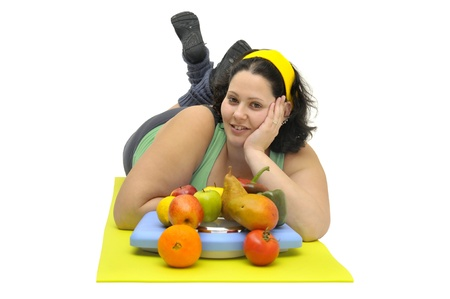 gluttonous: Large girl with fruit and vegetables isolated in white Stock Photo