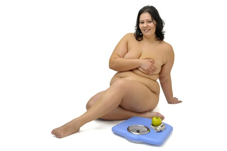 Beautiful large girl with weight scale isolated in white Stock Photo