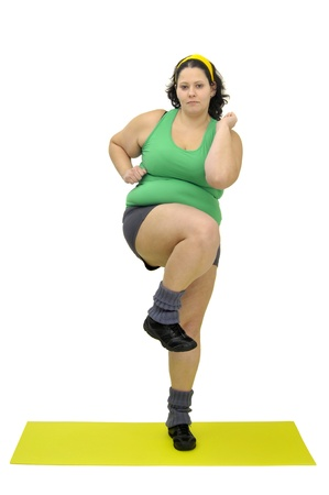 Large girl exercising isolated in white photo