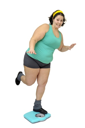 Large girl with weight scale isolated in white photo