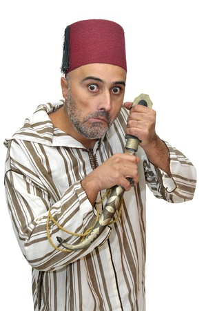 Arabic man with a dagger making funny faces isolated in white photo