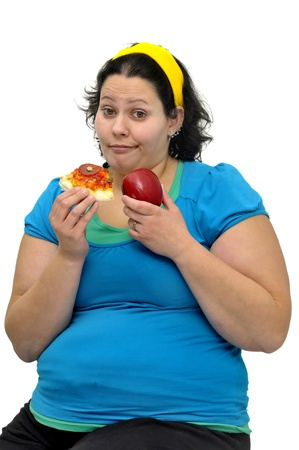 Large girl with an apple and a pizza slice isolated in white