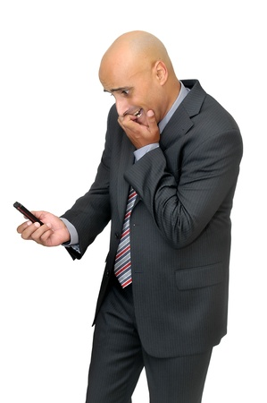 celphone: Stressed businessman with cellphone  Stock Photo