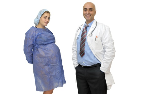 Pregnant woman and doctor isolated in white photo