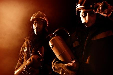 fireman helmet: Dramatic image of firemen team in uniform