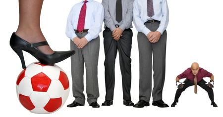 Barrier of businessmen with soccer ball waiting for a free kick isolated in white photo
