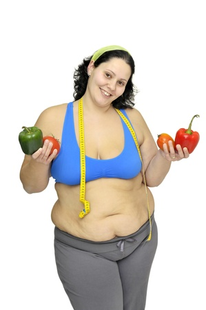Large girl with vegetables isolated in white Stock Photo - 9643551