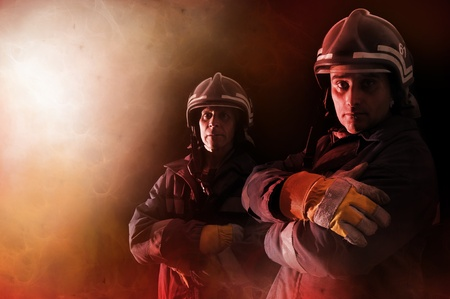 fireman helmet: Dramatic image of firemen team in uniform