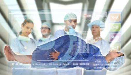 Doctors team with pregnant pacient in medical facilities with modern screen photo