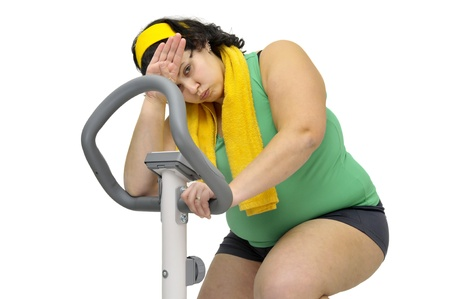 Large girl exercising isolated in white Stock Photo