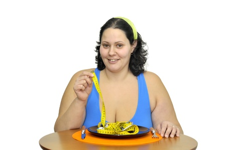 Large girl eating a measuring tape isolated in white Stock Photo - 9781353