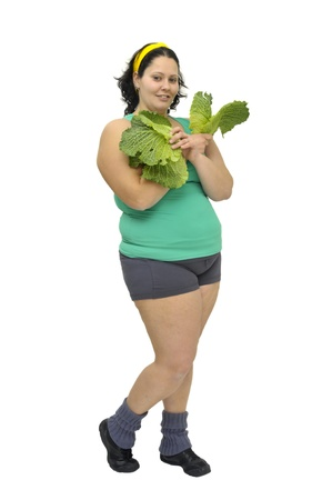 Large girl with vegetables isolated in white Stock Photo - 9781602