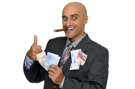 Businessman with money and a cigar isolated in white