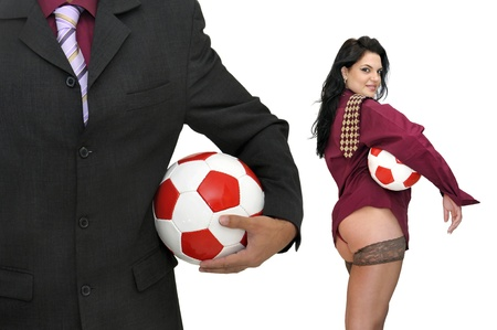 Businessman and woman with  soccer balls isolated in white photo